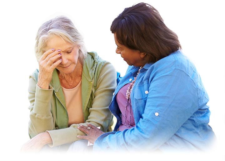 Grief and Bereavement Counseling: Woman Comforting Unhappy Senior Friend Outdoors